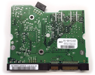 Hard drive PCB back with traces, contacts, solder points