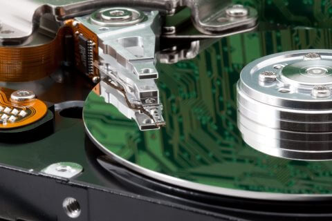 Hard disk platter and heads close-up with circuit reflection
