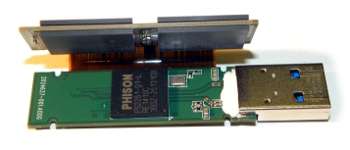 Bare internals of a 256GB USB flash drive showing 4 NAND chips