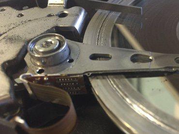 Scored disk platter trench